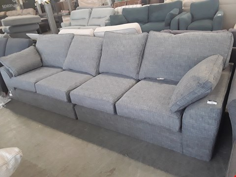 Lot 22 TWO QUALITY BRITISH DESIGNER GREY FABRIC SOFA SECTIONS COMPRISING A LARGE FOUR SEATER SOFA