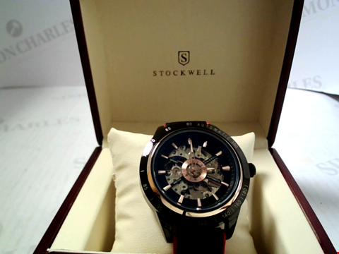 Lot 5625 DESIGNER STOCKWELL AUTOMATIC, SKELETON DIAL SPORTS WATCH WITH RED STRAP DETAILING RRP £600.00