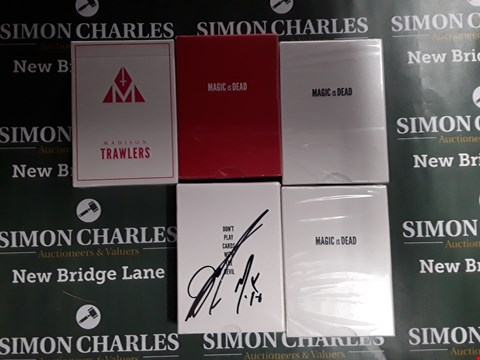 Lot 752 LOT OF 5 ASSORTED PACKS OF CARDS TO INCLUDE 3 PACKS MAGIC IS DEAD CARDS AND 2 PACKS OF MADISON TRAWLERS CARDS (ONE IS SIGNED)
