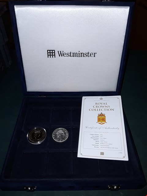 Lot 1070 WESTMINSTER ROYAL CROWNS COLLECTION HM QUEEN ELIZABETH II DIAMOND JUBILEE 2 DOLLAR COIN AND FINE SILVER 2 POUND COIN IN BLUE VELVET 12 SLOT DISPLAY CASE
