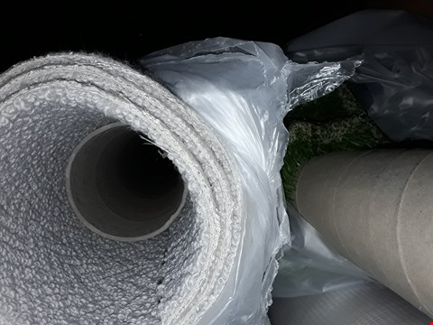 Lot 1040 A ROLL OF BEIGE CARPET AND ASTROTURF SIZE UNSPECIFIED