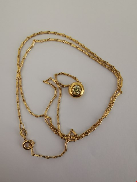 Lot 184 18CT YELLOW GOLD PENDANT ON CHAIN RUBOVER SET WITH A DIAMOND WEIGHING +/-0.3CT