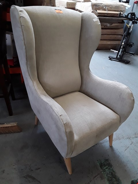 Lot 115 DESIGNER NATURAL FABRIC WINGED EASY CHAIR