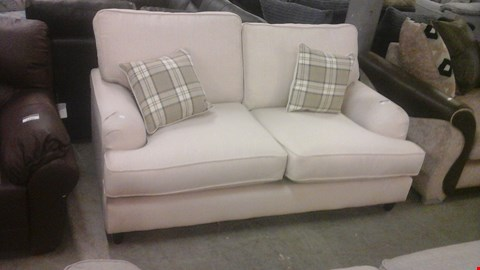 Lot 1239 DESIGNER CREAM FABRIC 2 SEATER SOFA