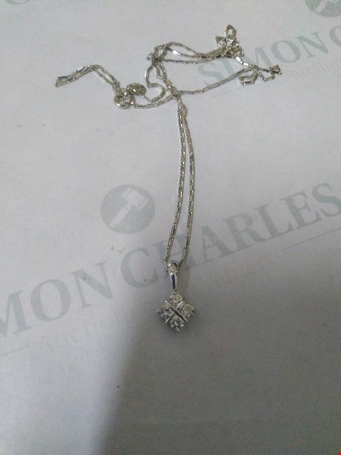 Lot 35 18CT WHITE GOLD PENDANT ON CHAIN SET WITH DIAMONDS WEIGHING +0.34CT RRP £1190.00