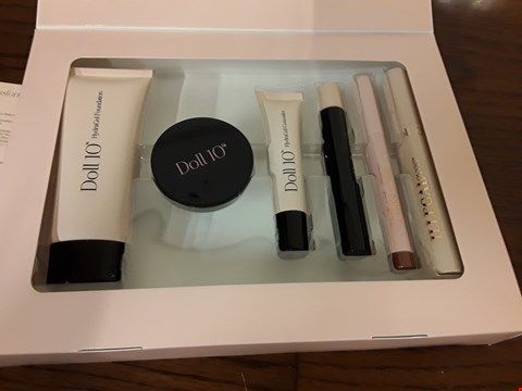 Lot 7018 DOLL 10 BEAUTY TRANSFORMATION BOX CONTAINING GEL LIP CRAYON, HYDRAGEL CREAM BALM, HYDRALUX SHADOW LINER AND ILLEGALEYES MASCARA
