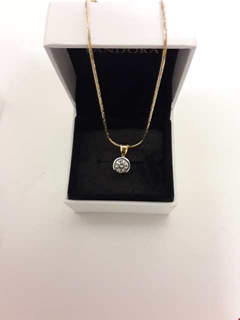 Lot 209 18CT GOLD PENDANT ON CHAIN RUBOVER SET WITH A DIAMOND WEIGHING +/- 0.82CT
