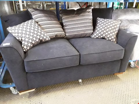 Lot 43 DESIGNER BLACK FABRIC TWO SEATER SOFA WITH SCATTER CUSHIONS