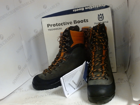 Lot 16055 BOXED PAIR OF DESIGNER HUSQVARNA PROTECTIVE BOOTS - UK SIZE 9.5