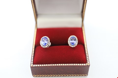 Lot 14 18CT WHITE GOLD OVAL TANZANITE EARRINGS WITH A DIAMOND HALO. TOTAL WEIGHT +-1.85CT