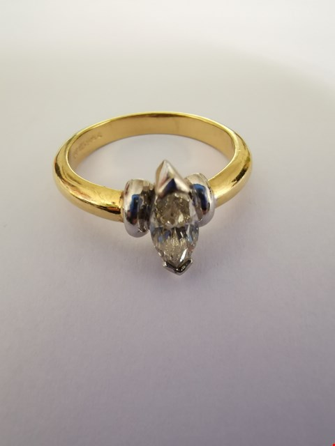 Lot 228 18CT GOLD RING SET WITH A MARQUISE CUT DIAMOND WEIGHING +/-0.72CT