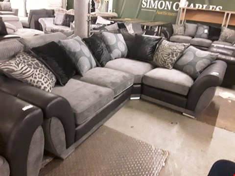 Lot 374 DESIGNER BLACK FAUX LEATHER AND GREY FABRIC CORNER SOFA WITH SCATTER BACK CUSHIONS