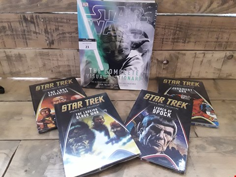Lot 23 FIVE BOOKS, STARS WARS THE VOMPLETE DICTIONARY & 4 VOLUMES STAR TREK GRAPHIC NOVEL COLLECTION ( shrink wrapped)