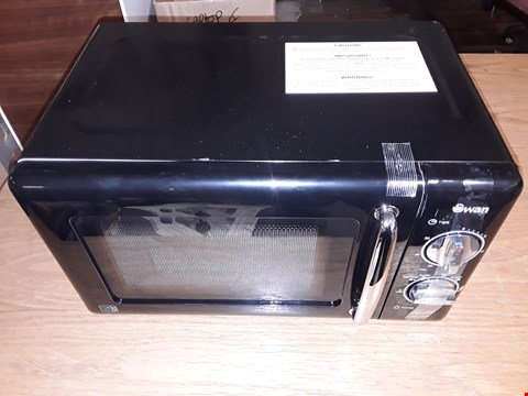 Lot 8118 UNBOXED SWAN 20L MANUAL MICROWAVE OVEN
