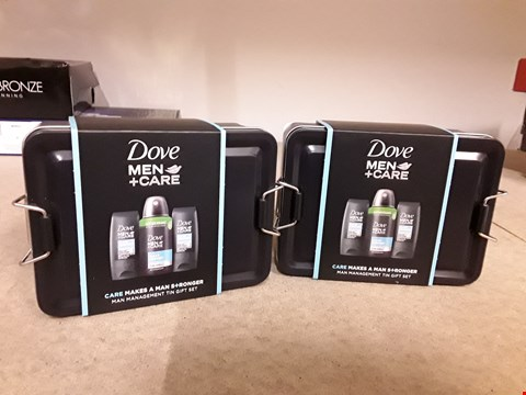 Lot 2033 LOT OF 2 DOVE MEN + CARE MAN MANAGEMENT TIN GIFT SETS