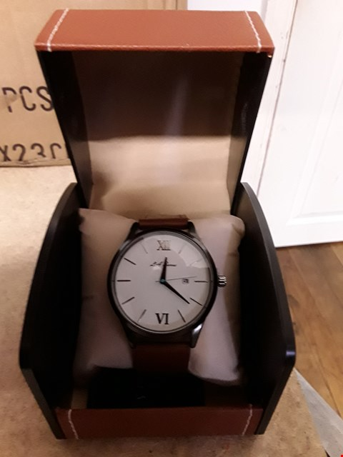 Lot 67 DESIGNER LA BANUS ROMAN  NUMERAL WRISTWATCH WITH WHITE DIAL AND BROWN  STRAP RRP £425