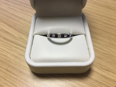 Lot 19 9CT WHITE GOLD HALF ETERNITY RING SET WITH ALTERNATING DIAMONDS AND SAPPHIRES WEIGHING +/-0.57CT