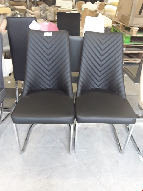 Lot 2 LOT OF 2 BLACK LEATHER DINING CHAIRS