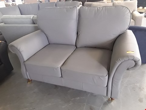 Lot 161 QUALITY BRITISH DESIGNER LIGHT GREY LEATHER SCROLL ARM TWO SEATER SOFA ON BRASS CASTORS