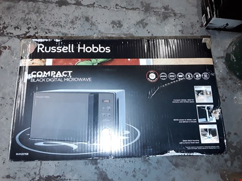 Lot 536 RUSSELL HOBBS COMPACT DIGITAL MICROWAVE