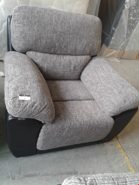 Lot 4 DESIGNED BLACK FAUX LEATHER AND GREY FABRIC MANUAL RECLINING ARMCHAIR