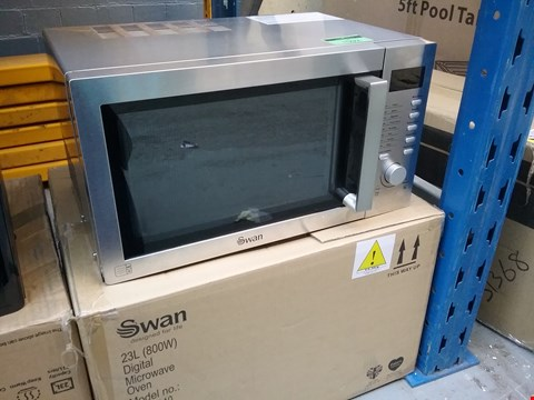 Lot 1592 SWAN 23L SOLO MICROWAVE OVEN SILVER RRP £250.00