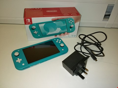 Lot 2169 NINTENDO SWITCH LITE TURQUOISE CONSOLE RRP £259.99