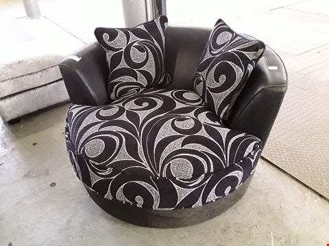 Lot 12 DESIGNER BLACK FAUX LEATHER & FLORAL FABRIC SWIVELL SNUGGLE CHAIR