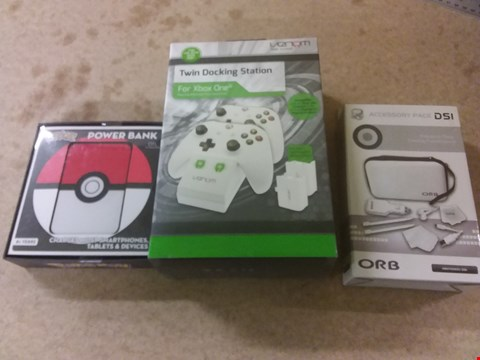 Lot 663 A BOX OF APPROXIMATELY 12 BRAND NEW ITEMS TO INCLUDE A TWIN DOCKING STATION FOR XBOX ONE, A POKEMON POWER BANK AND A ACCESSORY PACK