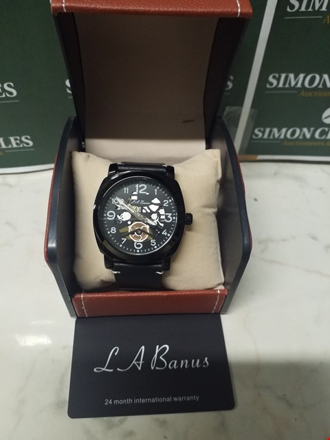 Lot 4592 L. A BANUS BLACK STAINLESS STEEL SKELETON WATCH WITH BLACK LEATHER WRIST STRAP
