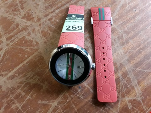 Lot 35 DESIGNER GUCCI WRIST WATCH ON RED STRAP