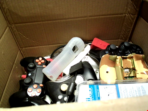 Lot 15660 BOX OF ASSORTED GAMES CONTROLLERS AND CABLES ETC