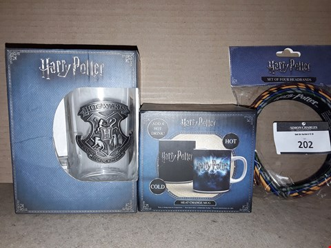 Lot 202 BOXED BRAND NEW HARRY POTTER HEAT CHANGE MUG, GLASS MUG AND SET OF 4 HEADBANDS