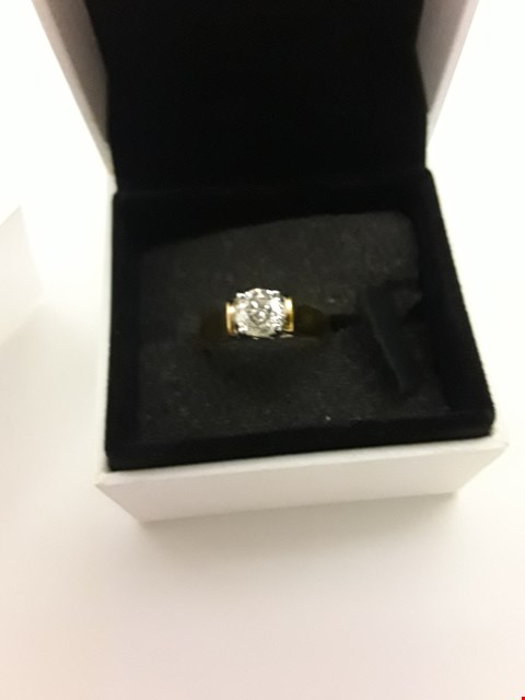 Lot 208 18CT GOLD SINGLE STONE RING SET WITH A DIAMOND WEIGHING +/-0.67