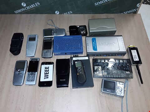 Lot 14328 LOT OF APPROXIMATELY 16 ASSORTED TECH ITEMS TO INCLUDE OLYMPUS DIGITAL VOICE RECORDER, FUJIFILM CAMERA AND VIDEO SPLITTER