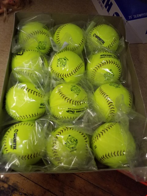 "Lot 2018 A BOX CONTAINING 12 11"" SLOWPITCH SOFTBALLS"
