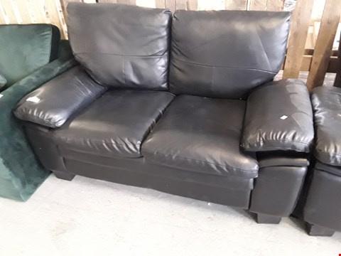 Lot 321 DESIGNER BLACK FAUX LEATHER TWO SEATER SOFA