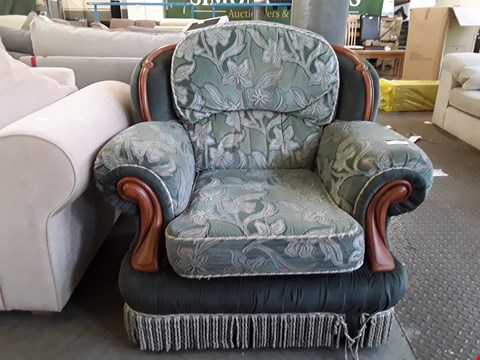 Lot 82 DESIGNER GREEN FLORAL PATTERNED FABRIC EASY CHAIR WITH WALNUT WOODEN DETAIL