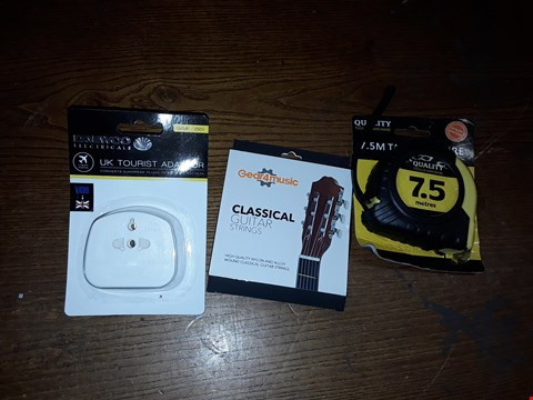 Lot 19 BOX OF ASSORTED ITEMS TO INCLUDE UK TOURIST ADAPTOR, CLASSICAL GUITAR STRINGS AND 7.5M TAPE MEASURE ECT  (BOX NOT INCLUDED)