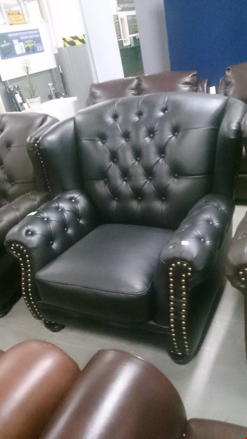 Lot 75 DESIGNER HARRINGTON BLACK LEATHER WING BACK ARMCHAIR WITH BUTTON AND STUDDED DETAIL