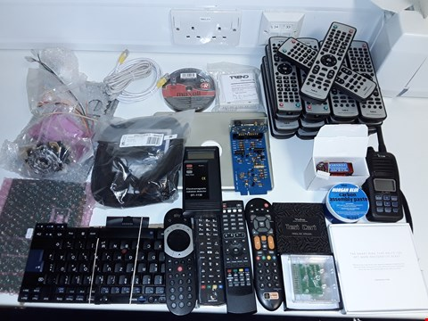 Lot 6473 LARGE QUANTITY OF ASSORTED TECH ITEMS TO INCLUDE PLANTRONICS STEREO HEADSET,ELF GEOMAGNETIC RADIATION DETECTOR AND VARIOUS REMOTE CONTROLLS