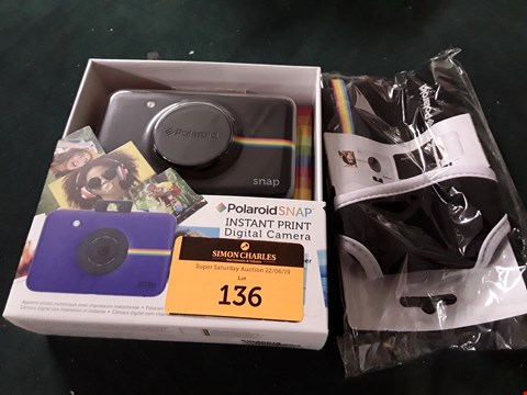 Lot 136 SNAP CAMERA WITH 20 SHEETS AND BLACK COVER  RRP £139.99
