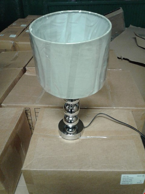 Lot 354 LOT OF 2 ASSORTED GRADE 1 LAMPS TO INCLUDE AN INGRID TABLE LAMP AND A TIA TABLE LAMP RRP £55