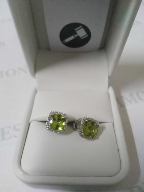 Lot 14 9CT WHITE GOLD EARRINGS SET WITH PERIDOT TO A DIAMOND HALO. TOTAL WEIGHT +3.42CT RRP £750.00