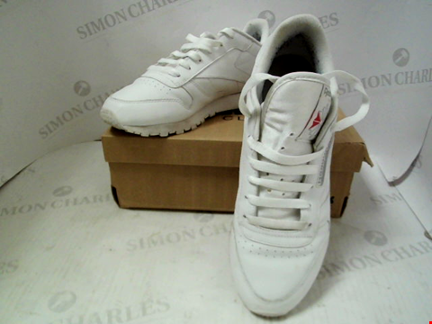 Lot 62 BOXED PAIR OF DESIGNER REEBOK CLASSICS - UK SIZE 7