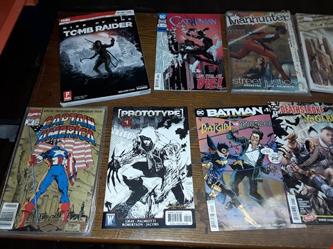 Lot 164 LOT OF APPROXIMATELY 12 COMMIC BOOKS TO INCLUDE DC MANHUNTER STREET JUSTICE, V FOR VRNDETTA, ULTIMATE IRON MAN AND RISE OF THE TOMB RAIDER ECT
