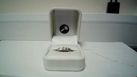 Lot 28 18CT WHITE GOLD RING SET WITH A DIAMOND AND DIAMONDS SET SHOULDERS RRP £1275.00