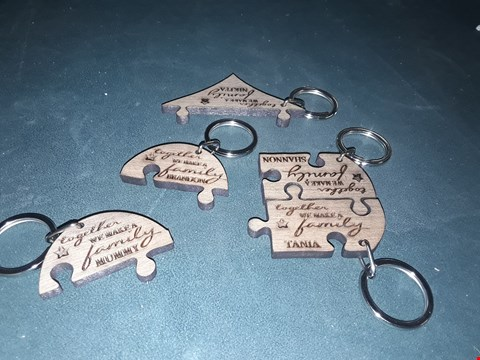 Lot 77 PERSONALISED OUR FAMILY WOODEN HEART JIGSAW KEYRING SET  RRP £25.00