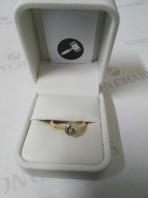 Lot 23 18CT GOLD RUBOVER SET WITH A DIAMOND WEIGHING +0.44CT RRP £1485.00
