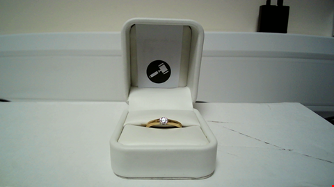 Lot 13 18CT GOLD RING SEMI RUBOVER WITH A DIAMOND RRP £975.00